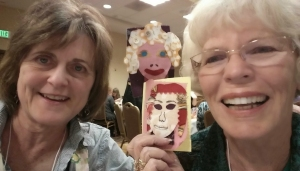 "Me on the left with my art partner for the evening. I am holding my ""portrait"" of her, and she is holding hers of me. What fun!"