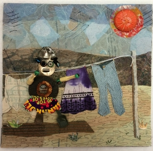 "Martha Ressler, Barb Hangs Out the Wash, fabric and found objects. 12 x 12"", framed."