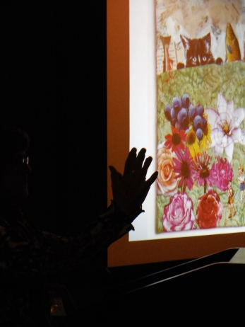 Me -- well my hand -- at Pecha Kucha. Photo by Eleanor Levie