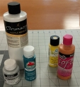 Paints -- on the left are regular acrylics to which I add textile medium for printing on fabric. On the right are textile paints. These are brands Tulip and FolkArt, but there are others.