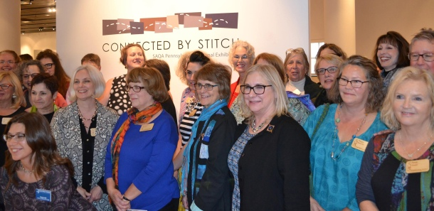Group shot, artists in Connected by Stitch